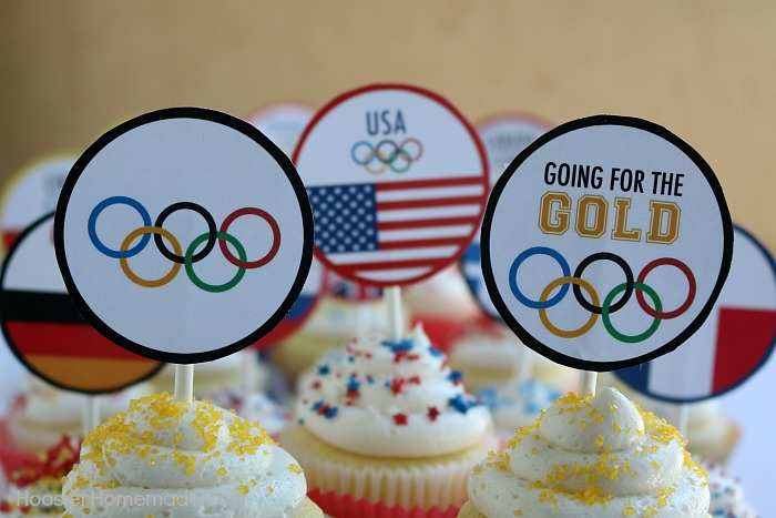 OLYMPIC CUPCAKE TOPPERS -- Celebrate the Olympic Games with these FREE PRINTABLE CUPCAKE TOPPERS! The kids will get a little history lesson with these World Flag Toppers!