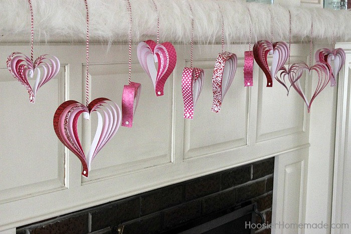 paper hearts hung from mantel