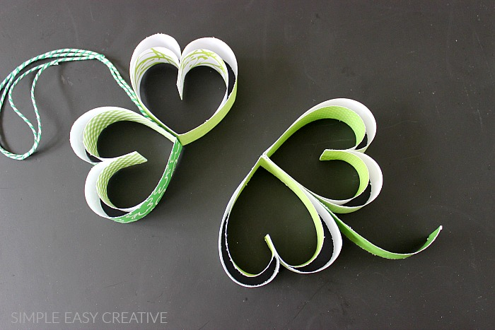 Attach hearts together to create shamrock