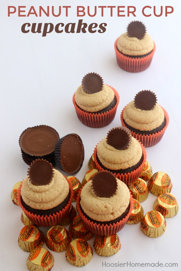 PEANUT BUTTER CUP CUPCAKES -- These Chocolate Cupcakes start with a moist, delicious recipe that includes peanut butter cups in the cupcakes, and topped with a creamy Peanut Butter Frosting! And of course, another Peanut Butter Cup on top!