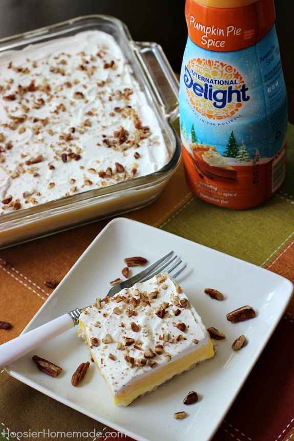 Pumpkin Cream Cheese Layered Dessert   Layers of cream cheese, whipped topping, pudding, and pecans on top of a sweet crust   Recipe on HoosierHomemade.com