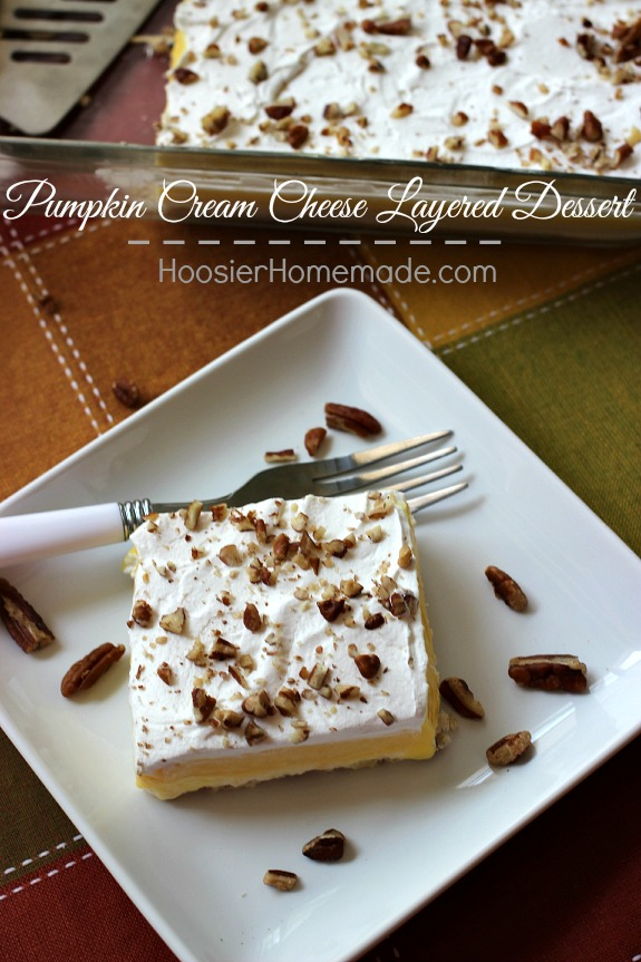Pumpkin Cream Cheese Layered Dessert | Layers of cream cheese, whipped topping, pudding, and pecans on top of a sweet crust | Recipe on HoosierHomemade.com