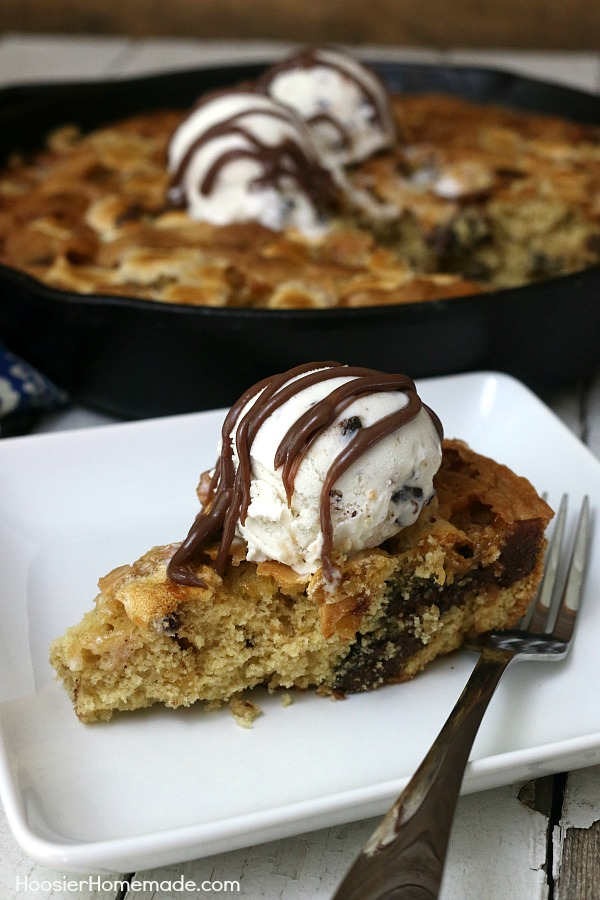 SKILLET COOKIE -- Warm right from the oven with a big scoop of Ice Cream! YUM! This Skillet Cookie Recipe is filled with Chocolate Chunks and Marshmallows!