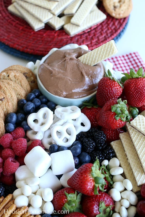 S'mores Dip with cookies, fruit and pretzels on a plate