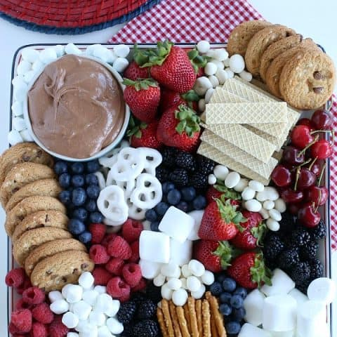 S'mores Dip on tray with fruit, cookies and pretzels