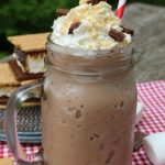 Do you LOVE S'mores? Love Iced Coffee? Well I have a treat for you! This S'mores Frappuccino Recipe is just like Starbucks but without the high cost!