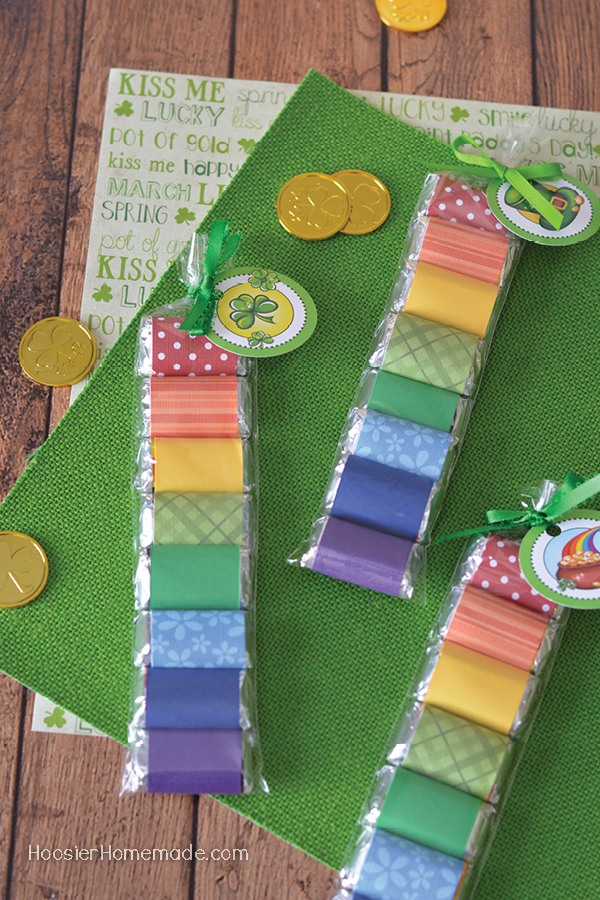 St. Patrick's Day Candy Wrapper - create a fun little treat for St. Patrick's Day with these candy bars wrapped in rainbow colors and tied with a FREE Printable St. Patrick's Day Tag!