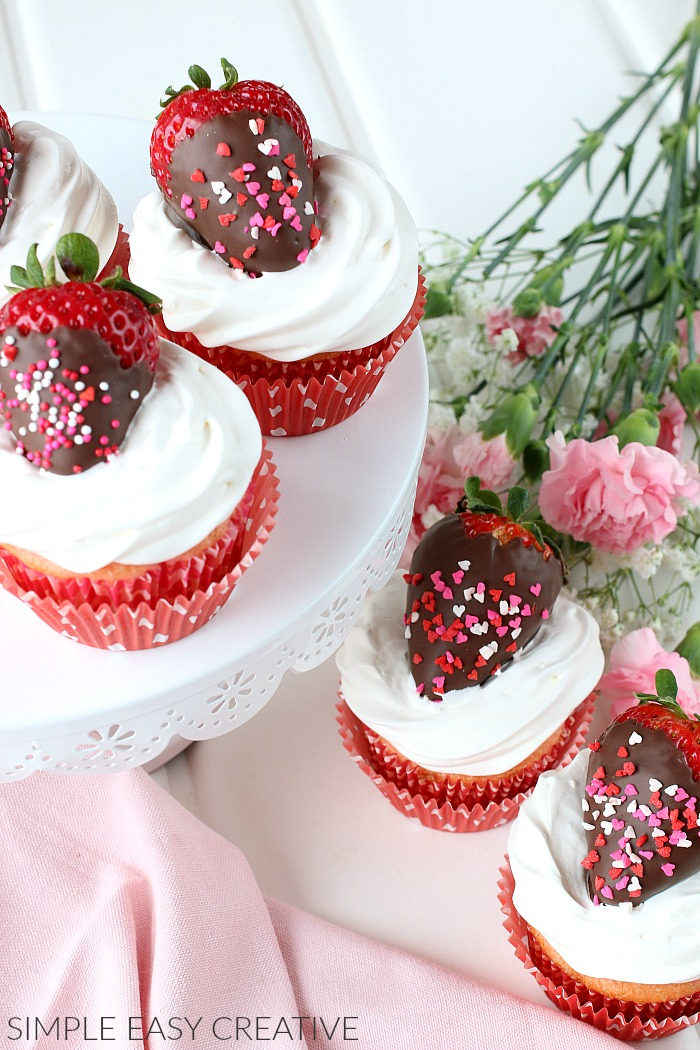 Strawberry Cupcakes filled with Strawberry Glaze and Marshmallow Frosting