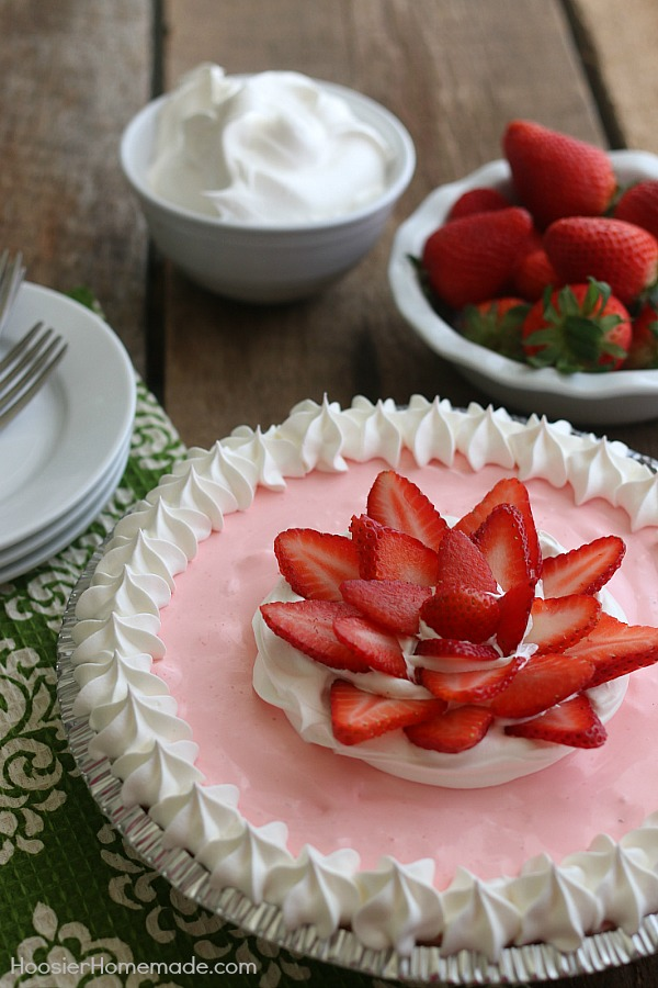 Only 4 ingredients is all you need for this delicious Easy Strawberry Cream Pie! Special enough for holidays yet easy enough for weeknight dessert!