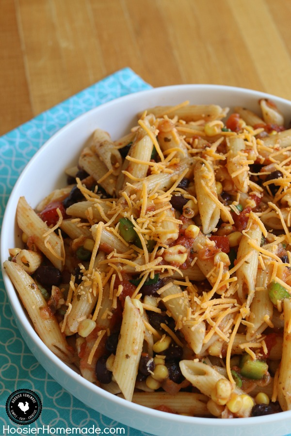 A simple Pasta Salad Recipe filled with your favorite Taco flavors! And bonus - it's healthy too! This Taco Pasta Salad is perfect for potlucks, picnics or for a side dish on Taco Night! Pin to your Recipe Board!