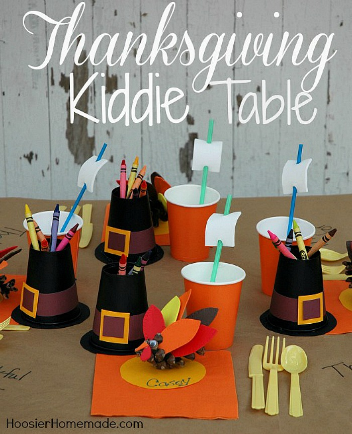 Create this fun space for the kids to enjoy their Thanksgiving Dinner! With just a few simple supplies, the kids will LOVE helping you make this Thanksgiving Kiddie Table complete with a Pilgrim Hat Crayon Holder, Mayflower Drinking Straws and Turkey Place Holders!