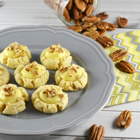 These simple thumbprint cookies start with a shortbread cookie and the filling is creamy vanilla like a cream puff. A sprinkle of pecans top them off. AND they have less sugar in them too!
