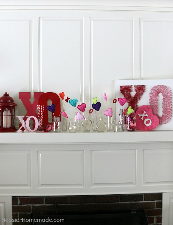 Valentine Decorating - Hugs and Kisses Mantel! Decorate your home with these easy ideas that had a little romance! Pin to your Valentine's Day Board!