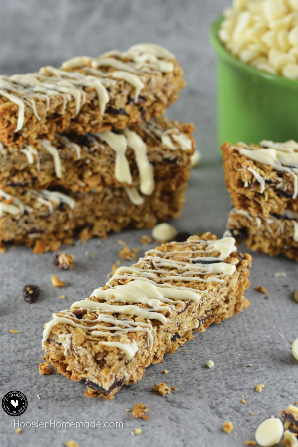Vanilla Chip Granola Bars - crunchy, good for you granola bars that packs a punch with flavor from cranberries, sunflower seeds, almonds, honey and melted vanilla chips! Perfect for breakfast on the go, after school snack or before your workout!