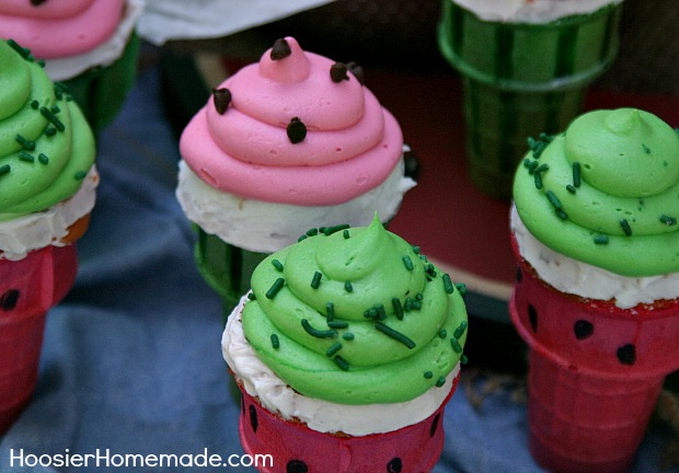 Watermelon Cupcake Cones | Watermelon flavored Cupcakes baked right in the Ice Cream Cones, makes a fun treat for Summer time! Recipe on HoosierHomemade.com
