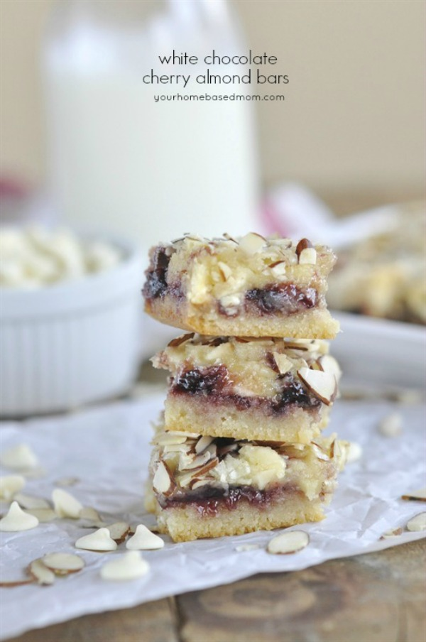 Layers of goodness! These White Chocolate Cherry Almond Bars are filled with cherry preserves, almonds and white chocolate chips! Visit our 100 Days of Homemade Holiday Inspiration for more recipes, decorating ideas, crafts, homemade gift ideas and much more!