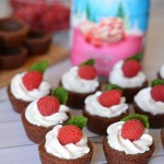 Chocolate Cookie Cups filled with White Chocolate Raspberry Cream - chocolate cookie cups that are similar to a shortbread cookie. Not too sweat, not super moist, but full of rich chocolate flavor. Top them with the super light, airy, fluffy White Chocolate Raspberry Cream and it's heaven!