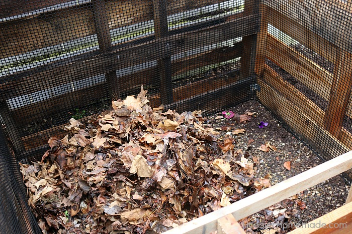 Add leaves to Wooden Pallet Compost Bin