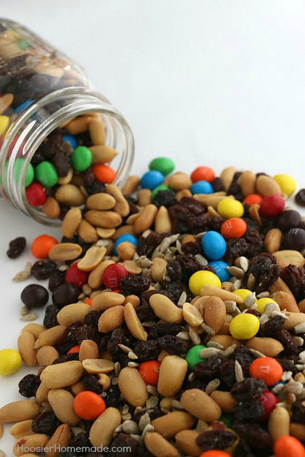 No need to buy those expensive snack mixes! This Recipe for Trail Mix is SUPER easy with only 4 ingredients! Whip up a batch in under 5 minutes and have snacks for after-school, traveling, games, movies and more!