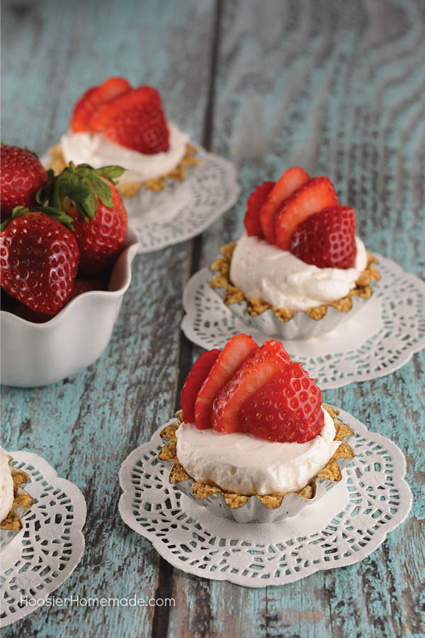 These Easy Mini Strawberry Cheesecakes are as fun to make as they are to eat. Perfect for any occasion! Impress your family and friends - SHH don't tell them they are super easy!